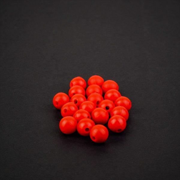 MAD CARP  Koraliki zderzakowe. Przekrój 8mm. Kolor czerwony.Koraliki wykonane z gumy (ENSOFT SX-300-15A-D2-000), idealne do zabezpieczania węzłów. 20 sztuk w opakowaniu.
