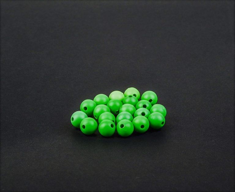 MAD CARP  Koraliki zderzakowe. Przekrój 8mm. Kolor zielony.Koraliki wykonane z gumy (ENSOFT SX-300-15A-D2-000), idealne do zabezpieczania węzłów. 20 sztuk w opakowaniu.