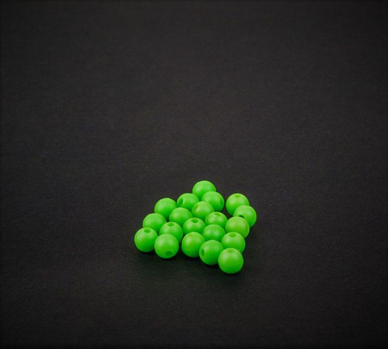 MAD CARP  Przekrój 6mm. Kolor zielony.Koraliki wykonane z gumy (ENSOFT SX-300-15A-D2-000), idealne do zabezpieczania węzłów. 20 sztuk w opakowaniu.