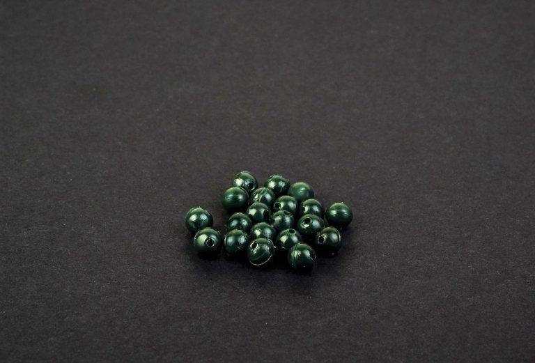 MAD CARP  Koraliki zderzakowe. Przekrój 4mm. Kolor zieleń zgniła. Koraliki wykonane z gumy (ENSOFT SX-300-15A-D2-000), idealne do zabezpieczania węzłów. 20 sztuk w opakowaniu.